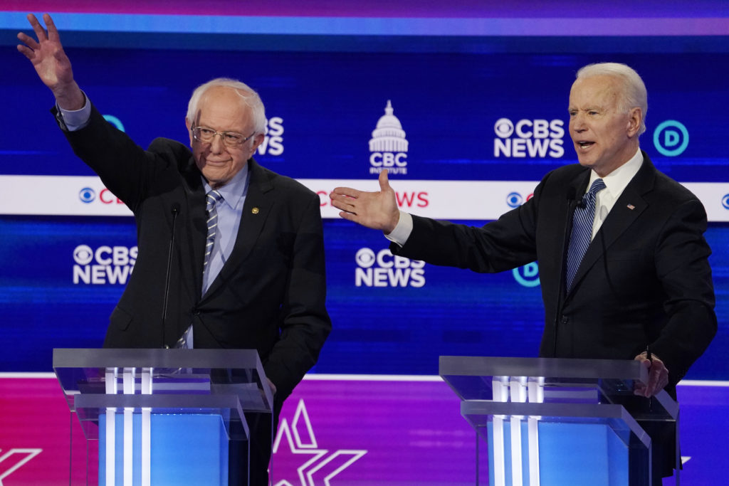 Democratic 2020 U.S. presidential candidates Senator Bernie Sanders and former Vice President Joe Biden participate in the tenth Democratic 2020 presidential debate at the Gaillard Center in Charleston, South Carolina, February 25, 2020. Photo by Jonathan Ernst/Reuters