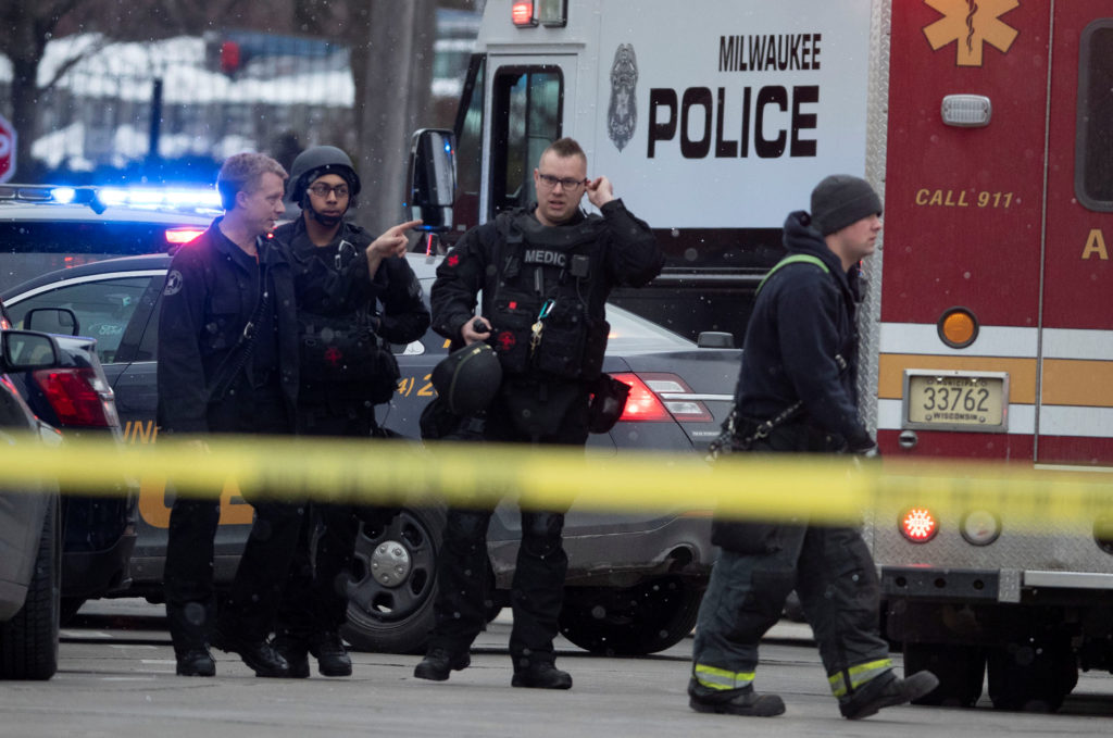 Police and emergency officials work at an active shooter scene at t…