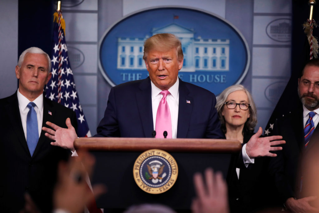 U.S. President Donald Trump answers a question during a news conference on the coronavirus outbreak at the White House in ...