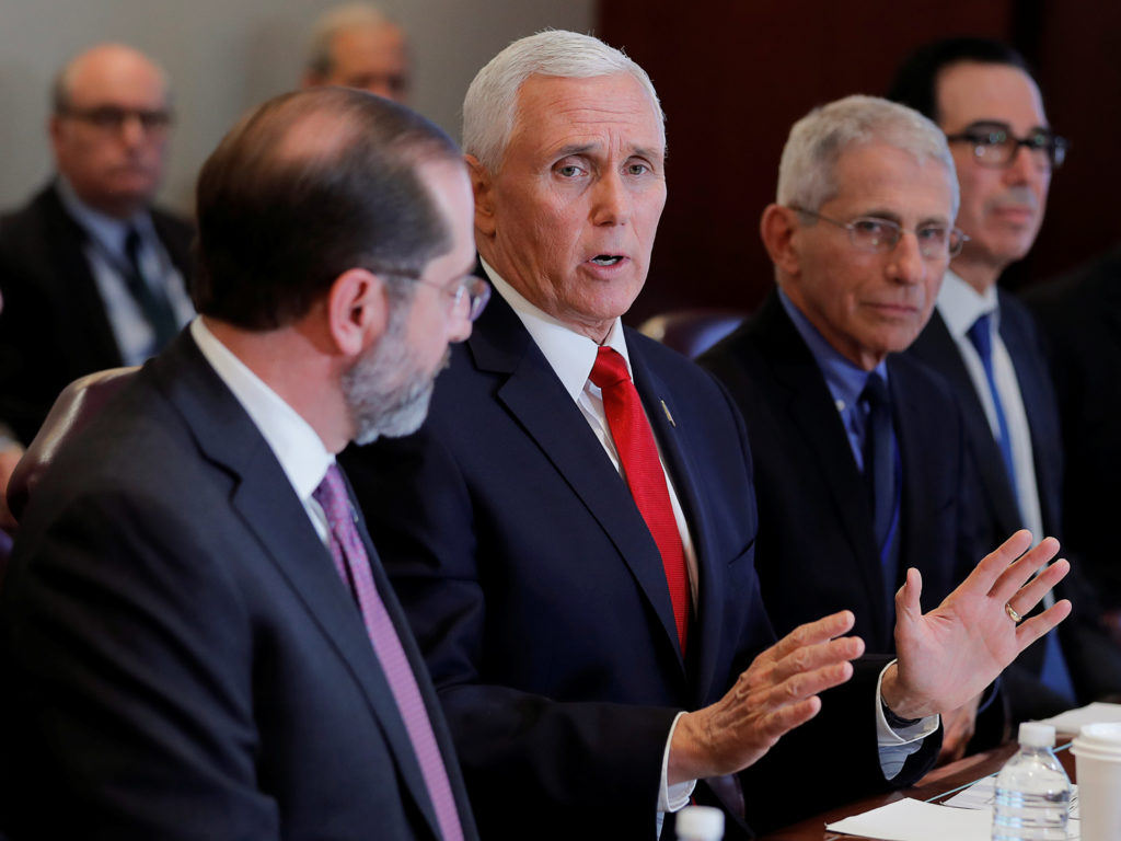 U.S. Vice President Mike Pence is seated with Health and Human Services (HHS) Secretary Alex Azar; Anthony Fauci, director...
