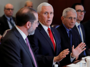 U.S. Vice President Mike Pence is seated with Health and Human Services (HHS) Secretary Alex Azar; Anthony Fauci, director of the NIH National Institute for Allergy and Infectious Diseases, and U.S. Treasury Secretary Stephen Mnuchin as he leads a coronavirus task force meeting at the Department of Health and Human Services in Washington, U.S., February 27, 2020. Photo by Carlos Barria/Reuters
