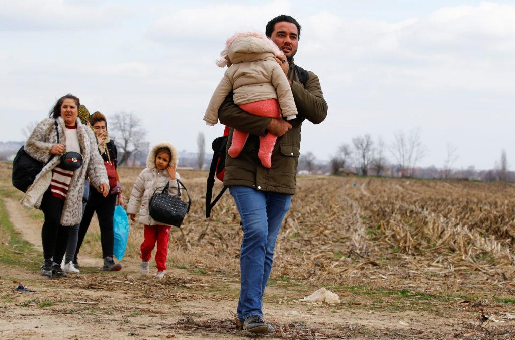 Migrants walk to the Turkey's Pazarkule border crossing with Greece…