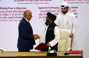 Mullah Abdul Ghani Baradar, the leader of the Taliban delegation, and Zalmay Khalilzad, U.S. envoy for peace in Afghanistan, shake hands after signing an agreement at a ceremony between members of Afghanistan's Taliban and the U.S. in Doha, Qatar February 29, 2020. Photo by Ibraheem al Omari/Reuters
