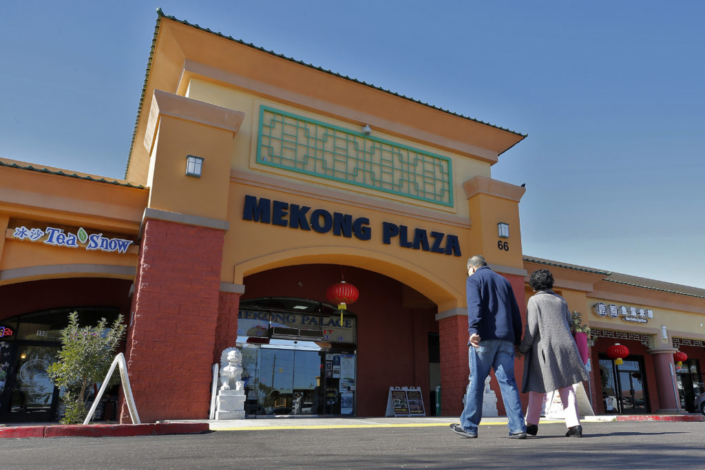 Patrons enter Mekong Plaza in the Asian district, in Mesa, Ariz. Arizona's freshly crowned Asian District was deep into or...