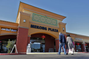 Patrons enter Mekong Plaza in the Asian district, in Mesa, Ariz. Arizona's freshly crowned Asian District was deep into organizing its night market when news broke that a case of the illness known as COVID-19 was confirmed at nearby Arizona State University. Photo by Matt York/AP.