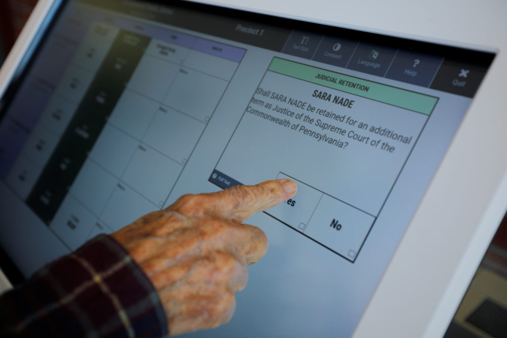 Reliability of pricey new voting machines questioned | PBS NewsHour Weekend