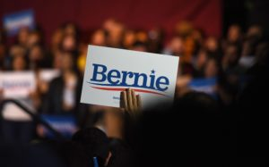 A supporter of U.S. Democratic presidential candidate Senator Bernie Sanders up a campaign sign after he was declared the winner of the Nevada Caucus during a campaign rally in San Antonio, Texas, U.S. February 22, 2020. REUTERS/Callaghan O'Hare - HP1EG2N068ZIJ