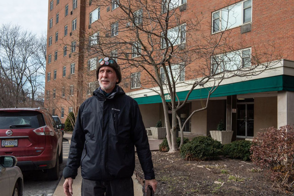 Robert Toth leaving his apartment in Lakewood, Ohio to walk to a nearby park with art sculptures. Toth has lived with HIV/AIDS for the past 32 years. Credit: Bridget Caswell