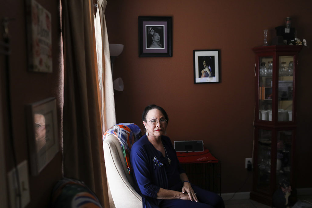 Stephanie Stuart at home in New Port Richey, Fla., where she displays memorabilia from competing over the last 35 years for titles like Miss Tampa Pride and Miss Daytona. Stuart was diagnosed with HIV 27 years ago.  Photo Credit: Eve Edelheit