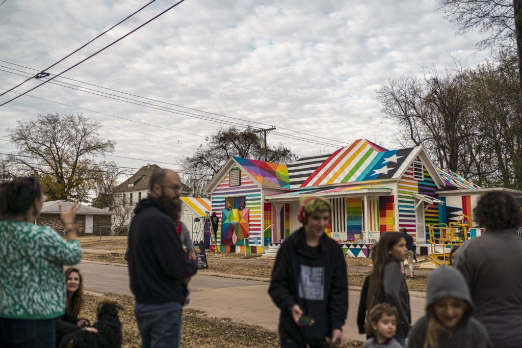 "Fort Smith, Arkansas, residents watch as Okuda San Miguel paints his ""Rainbow Embassy."" Photo courtesy of 64.6 Downtown"