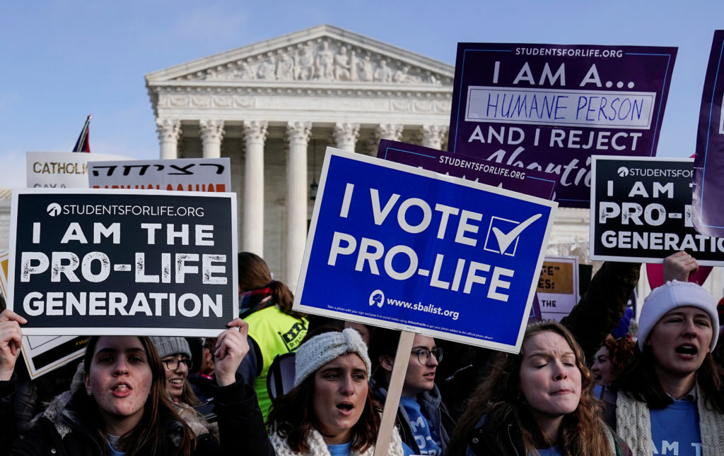 Anti-abortion marchers rally at the Supreme Court during the 46th a…