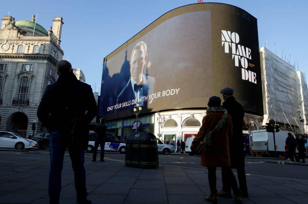 """A film trailer for the 25th installment in the James Bond series entitled """"No Time to Die"""" is displayed at Piccadilly Circ..."""
