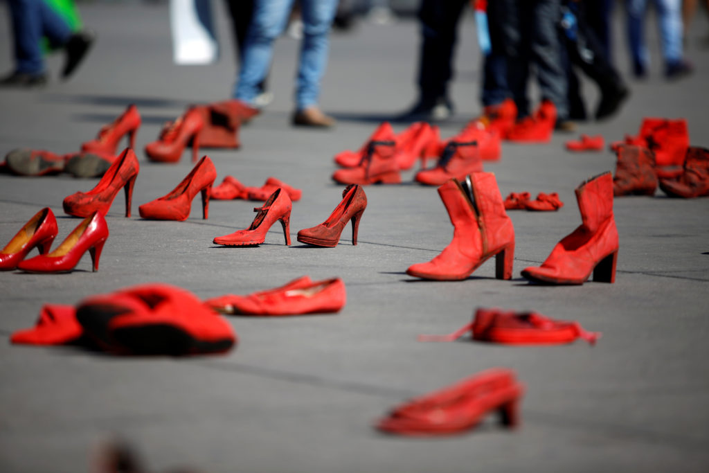 Pairs of women's red shoes seen in the Zocalo square in Mexico City, Mexico, for the Jan. 11 protest. Photo by Gustavo Graf/Reuters