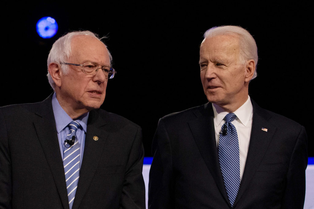 Democratic 2020 U.S. presidential candidates U.S. Senator Bernie Sanders and former Vice President Joe Biden take the stage for the tenth Democratic 2020 presidential debate at the Gaillard Center in Charleston, South Carolina, U.S. February 25, 2020. REUTERS/Randall Hill