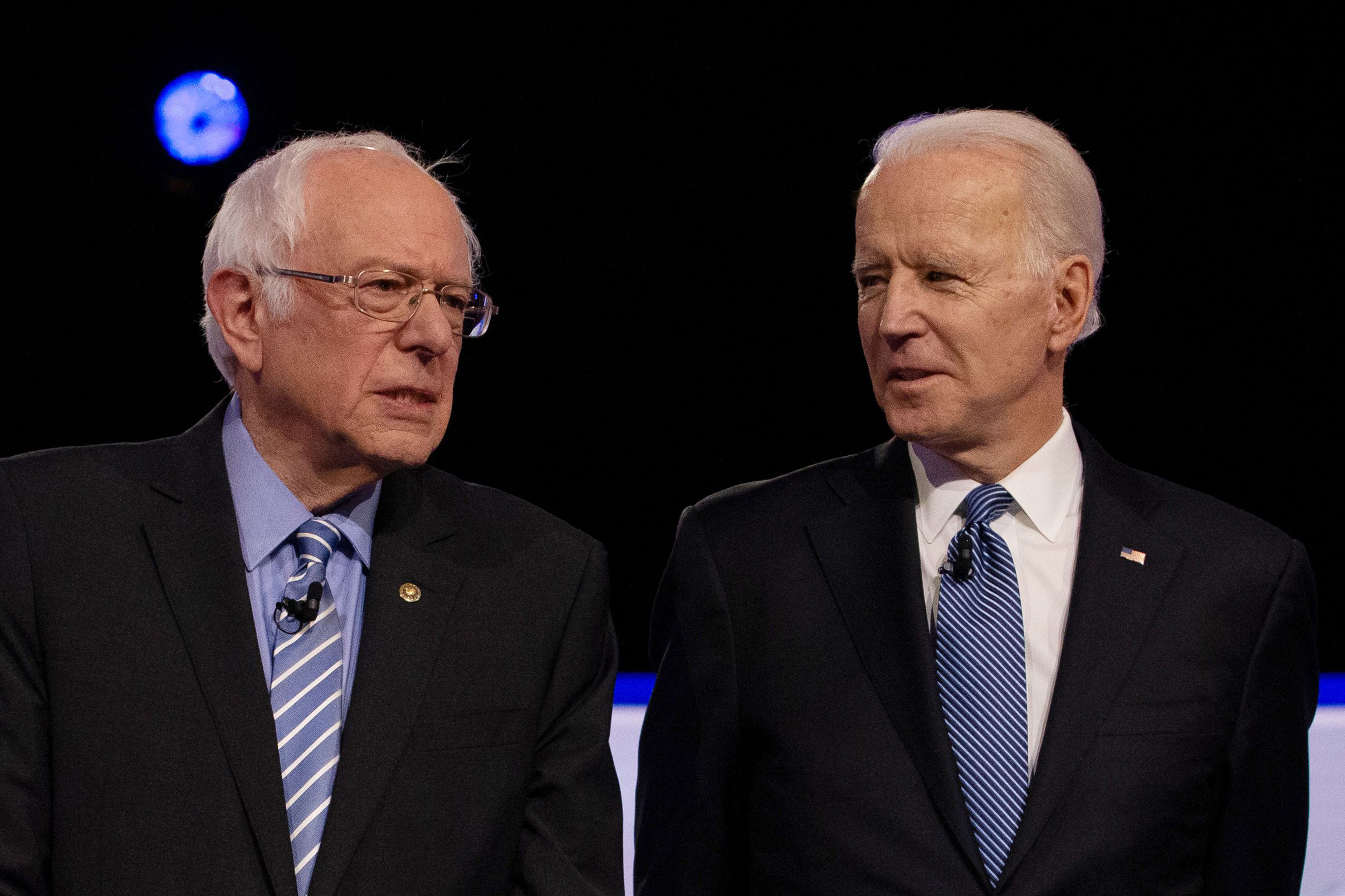 Democratic 2020 U.S. presidential candidates U.S. Senator Bernie Sanders and former Vice President Joe Biden take the stage for the tenth Democratic 2020 presidential debate at the Gaillard Center in Charleston, South Carolina, U.S. February 25, 2020. REUTERS/Randall Hill