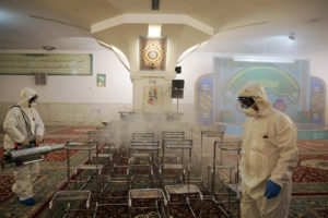 Members of the medical team spray disinfectant to sanitize indoor place of Imam Reza's holy shrine, following the coronavirus outbreak, in Mashhad, Iran February 27, 2020. Photo by WANA (West Asia News Agency) via Reuters