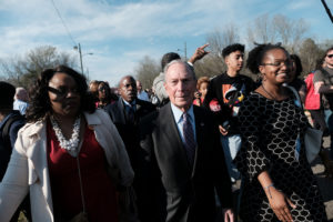 "Presidential candidate Michael Bloomberg participates in a march crossing the Edmund Pettus Bridge to commemorate the 55th anniversary of the ""Bloody Sunday"" march in Selma, Alabama, March 1, 2020. Photo by Michael A. McCoy/Reuters"