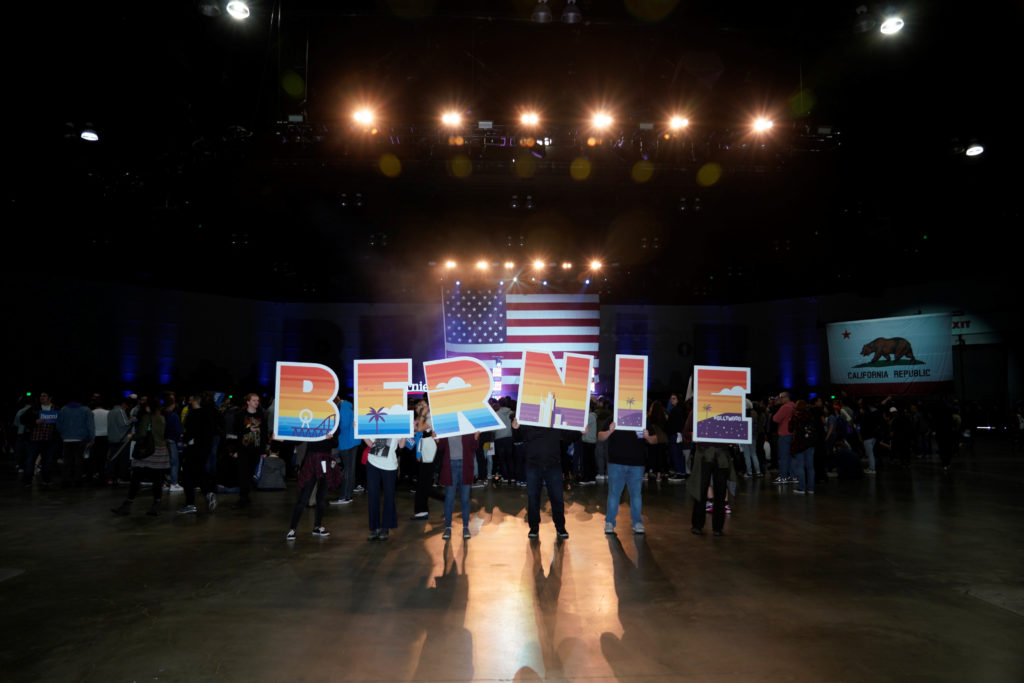 Supporters of Democratic 2020 presidential candidate Senator Bernie Sanders hold up signs during a campaign rally in Los Angeles. Photo by Kyle Grillot/Reuters