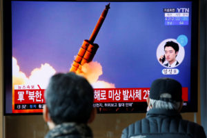 People watch a TV showing a file picture for a news report on North Korea firing two unidentified projectiles, in Seoul, South Korea, March 2, 2020. Photo by Heo Ran/Reuters