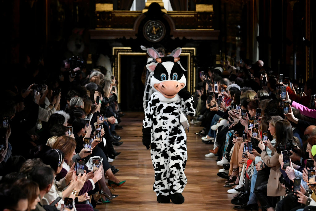 A person wearing a cow costume walks with models on the catwalk at the end of Stella McCartney Fall/Winter 2020/21 women's ready-to-wear collection show during Paris Fashion Week in Paris, France, March 2, 2020. Photo by Piroschka van de Wouw/Reuters