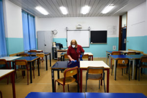 A cleaner sanitizes a classroom at the Piero Gobetti high school in Turin, as part of measures to try and contain a coronavirus outbreak in Italy. Photo by Massimo Pinca/Reuters