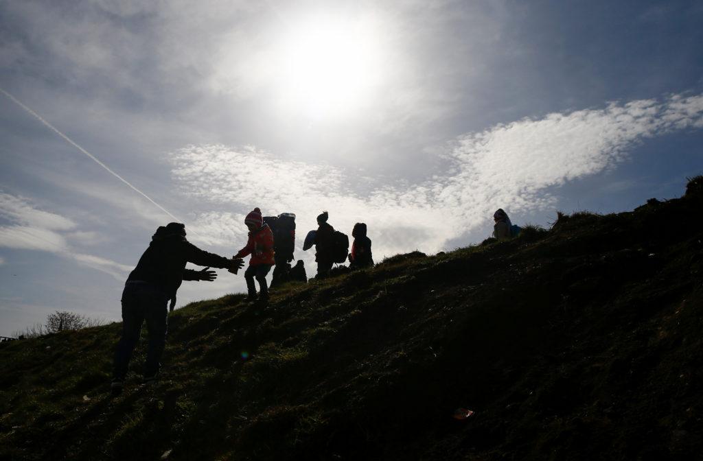 Migrants walk, near the Turkey's Pazarkule border crossing with Greece's Kastanies, near Edirne, Turkey, March 3, 2020. Ph...