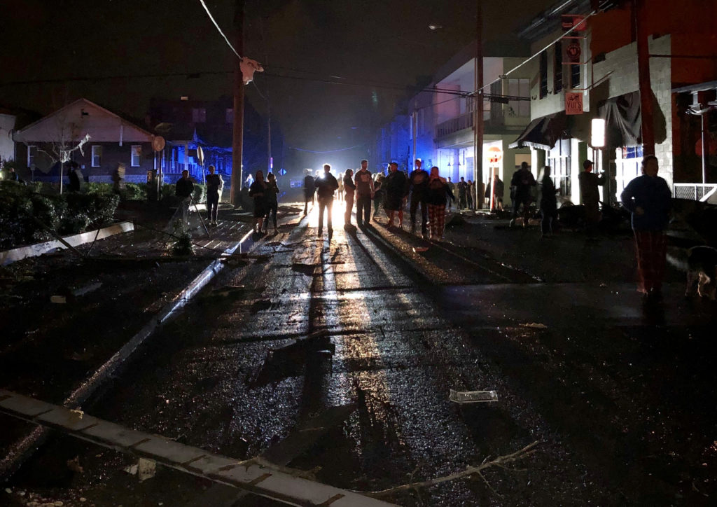 People gather amid damages caused by a tornado in Nashville, Tennes…