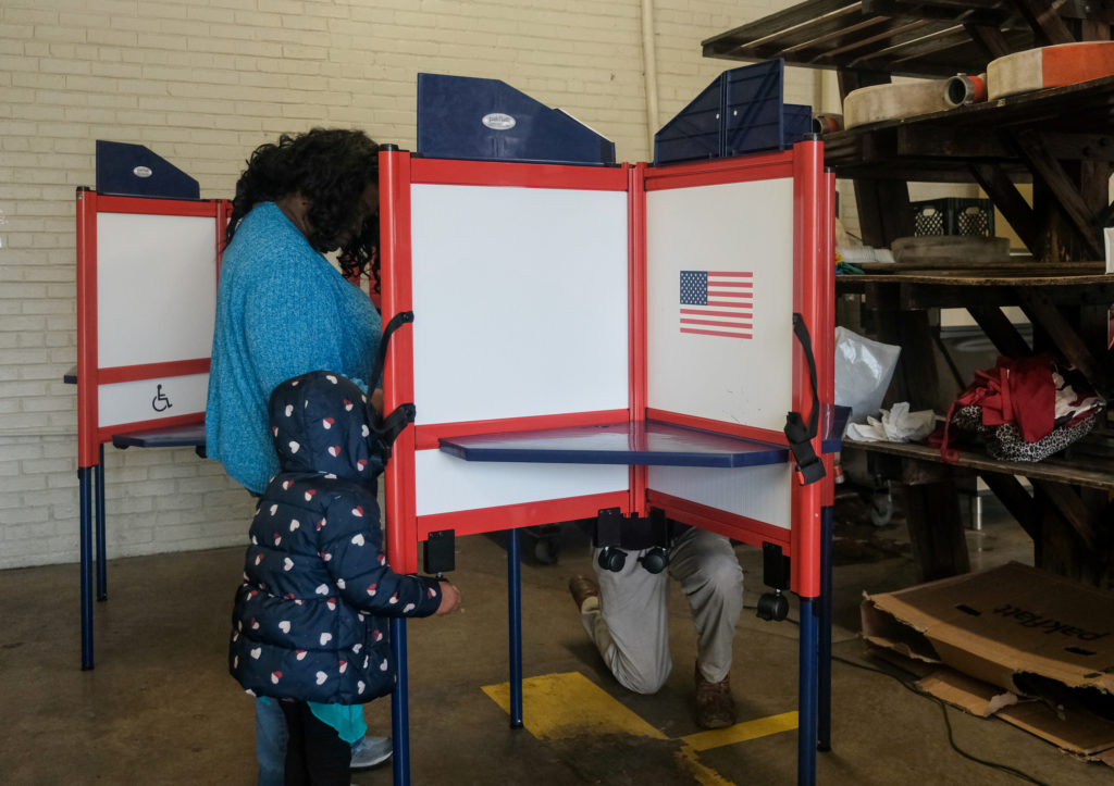 A voter cast a ballot for 2020 Democratic Primary Election inside of a polling station at the Selma Fire Station on Super ...