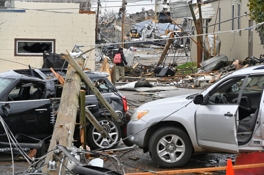 Damage to buildings and vehicles is seen after a tornado hit eastern Nashville, Tennessee. Photo by Harrison McClary/Reuters