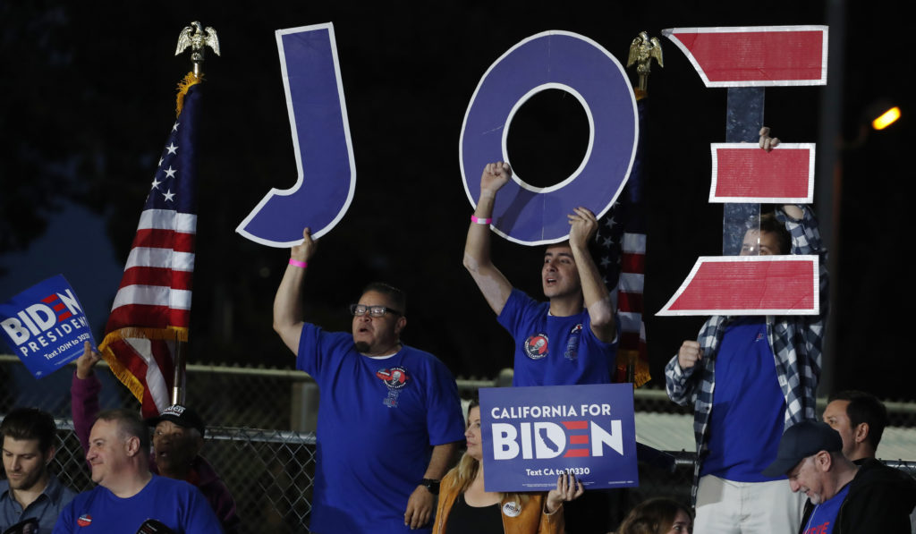 Supporters of Democratic U.S. presidential candidate and former Vice President Joe Biden cheer at his Super Tuesday night rally in Los Angeles, California, U.S., March 3, 2020. Photo by Mike Blake/Reuters