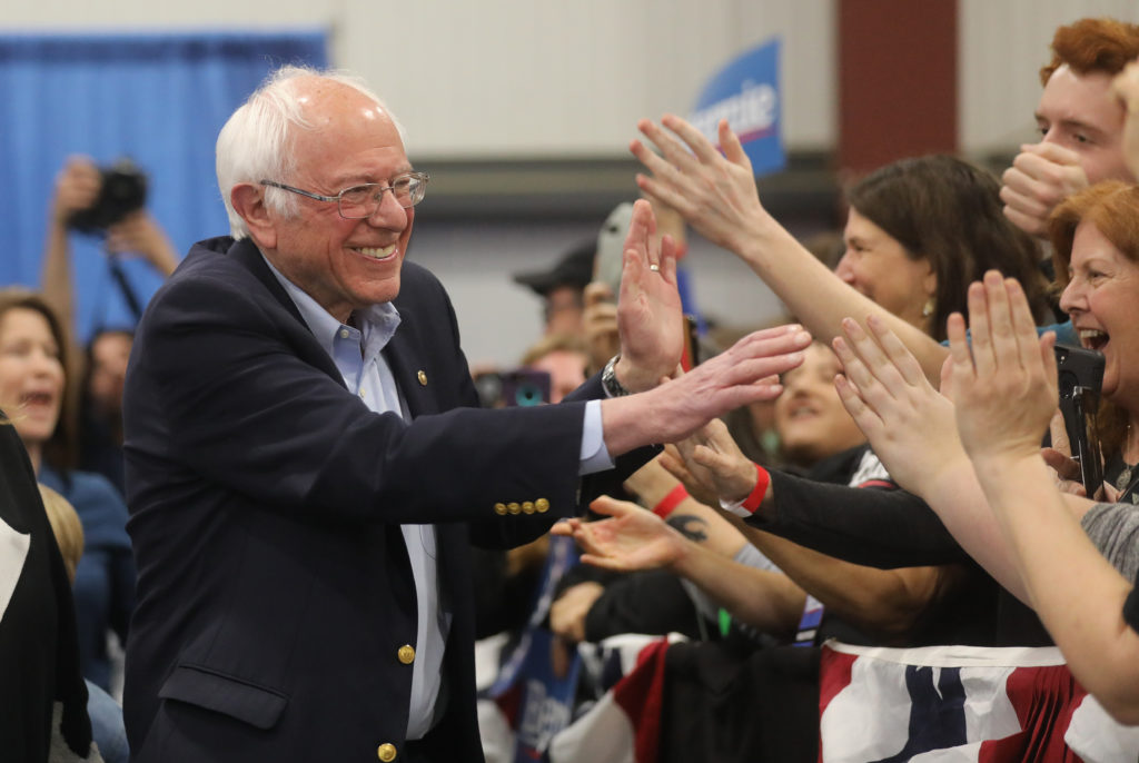 Democratic U.S. presidential candidate Senator Bernie Sanders greets supporters at his Super Tuesday night rally in Essex ...