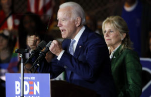 Democratic U.S. presidential candidate and former Vice President Joe Biden addresses supporters as his wife Jill looks on at his Super Tuesday night rally in Los Angeles, California, U.S., March 3, 2020. Photo by Mike Blake/Reuters