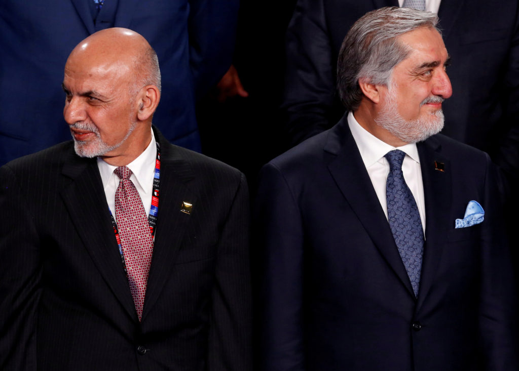 FILE PHOTO: Afghanistan's President Ashraf Ghani (L) and Afghanistan's Chief Executive Abdullah Abdullah (R) participate i...