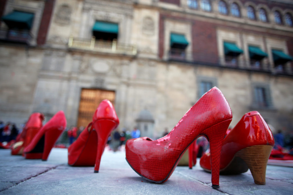 "Pairs of women's red shoes seen during the March 9 ""A Day Without Us"" protest, outside the National Palace in Mexico City. Photo by Gustavo Graf/Reuters"