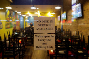 Signs are displayed on the window of a restaurant to inform customers that the dinning area is closed as Illinois Governor J.B. Pritzker ordered all restaurants and bars closed at the end of the business day, as part of efforts to combat the spread of the novel coronavirus, in Chicago. Photo by Joshua Lott/Reuters