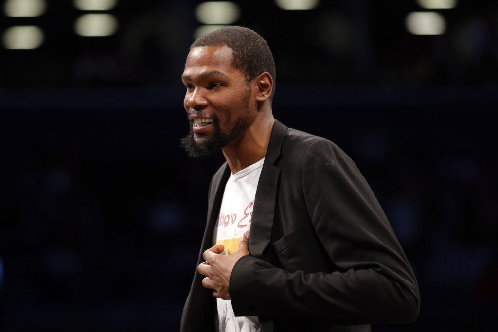 Feb 3, 2020; Brooklyn, New York, USA; Brooklyn Nets small forward Kevin Durant (7) smiles during a time out during the sec...