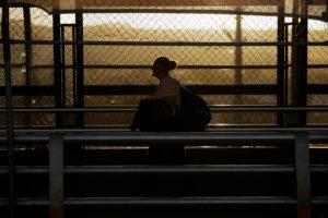 FILE PHOTO: A woman walks towards El Paso, Texas, U.S. at the international border bridge Paso del Norte, as seen from Ciudad Juarez, Mexico March 13, 2020. REUTERS/Jose Luis Gonzalez/File Photo