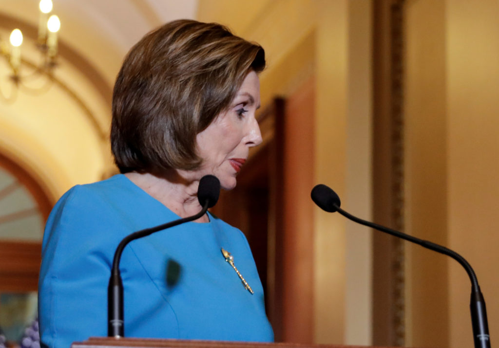 FILE PHOTO: U.S. House Speaker Nancy Pelosi (D-CA) turns to leave after delivering a statement on a coronavirus economic aid package ahead of a vote on the legislation in the House of Representatives on Capitol Hill in Washington, U.S., March 13, 2020. REUTERS/Yuri Gripas/File Photo