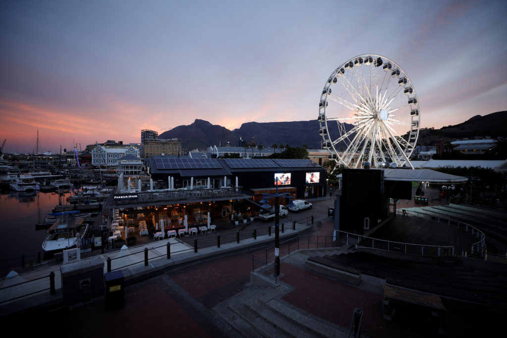 Dusk falls in the popular Waterfront district in Cape Town, South Africa, shortly before President Cyril Ramaphosa announc...