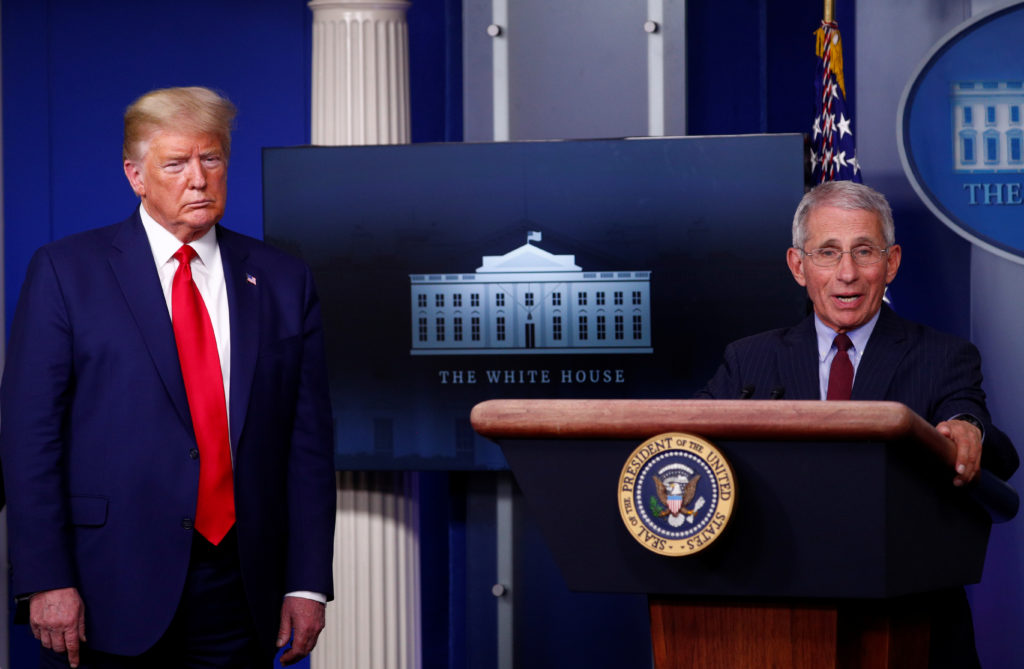 Dr. Anthony Fauci, Director of the National Institute of Allergy and Infectious Diseases, addresses the daily coronavirus response briefing as as U.S. President Donald Trump listens at the White House in Washington, on March 31, 2020. Photo by REUTERS/Tom Brenner