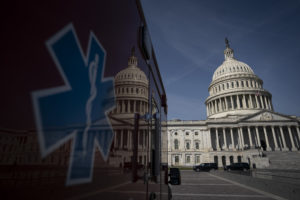 WASHINGTON, DC - MARCH 16: An ambulance sits parked on the plaza outside the U.S. Capitol March 16, 2020 in Washington, DC. After taking the weekend off, the Senate will return on Monday afternoon and will take up the House-passed coronavirus relief bill. The legislation in the House bill includes some provisions for paid emergency leave and free COVID-19 testing. (Photo by Drew Angerer/Getty Images)
