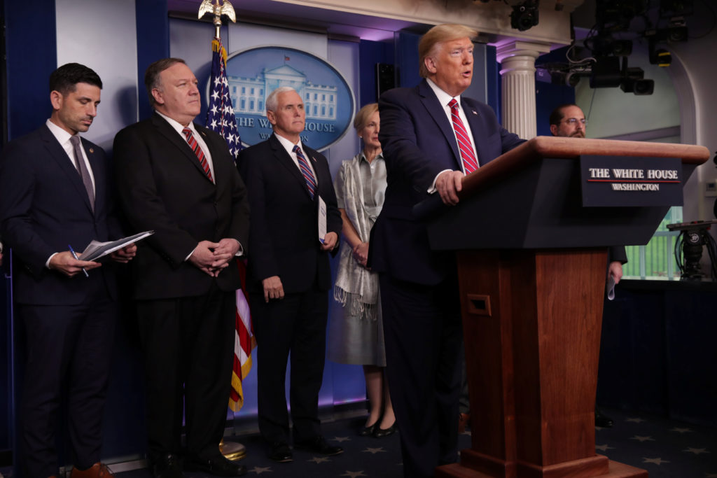 U.S. President Donald Trump addresses his administration's daily coronavirus task force briefing flanked by Acting Secreta...