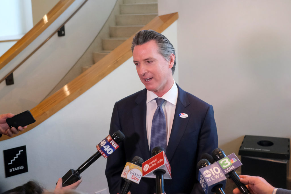 California's Governor Gavin Newsom speaks to the media after casting his vote at a voting center at The California Museum ...