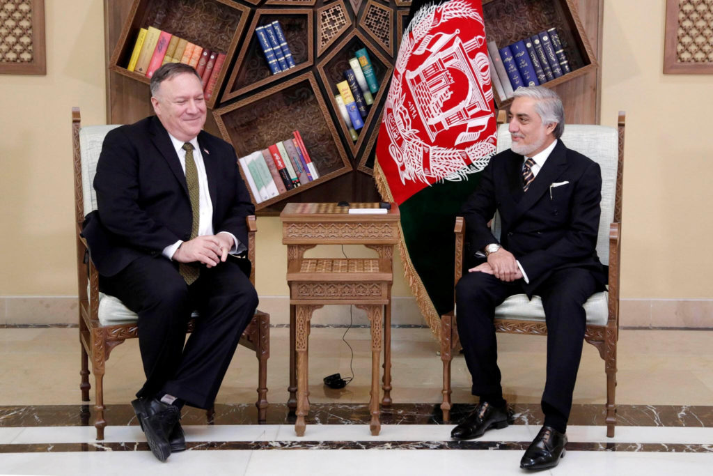 Afghanistan's Abdullah Abdullah, President Ashraf Ghani's political rival, meets with U.S. Secretary of State Mike Pompeo in Kabul, Afghanistan March 23, 2020. Afghanistan's Chief Executive Office/Handout via REUTERS