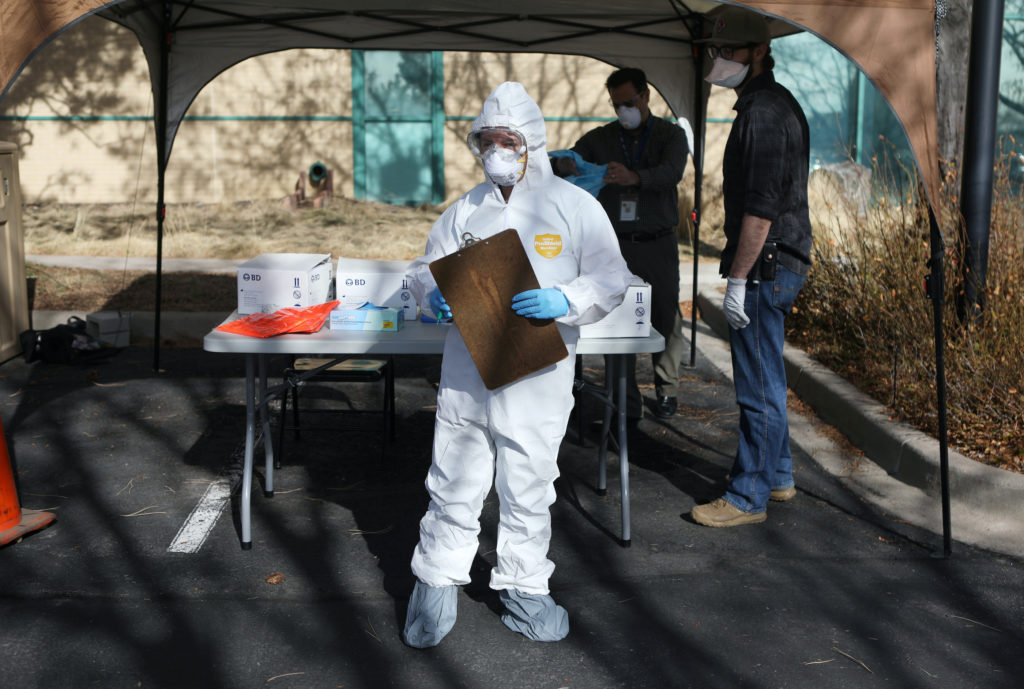 Health care workers prepare a drive-thru testing station run by the state health department, for people who suspect they have novel coronavirus, in Denver, Colorado, U.S. March 11, 2020. REUTERS/Jim Urquhart