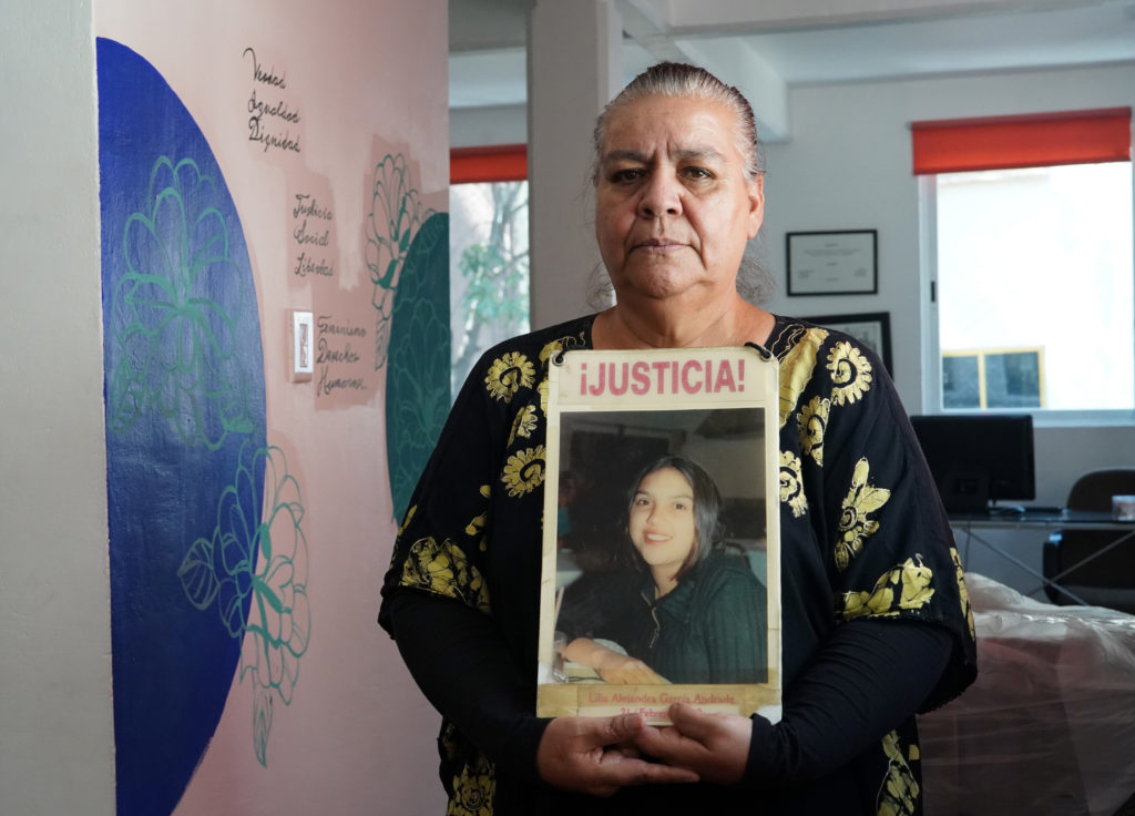 Norma Andrade holds a photo of her daughter, who was killed in 2001. Photo by Joshua Barajas