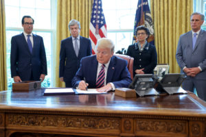 U.S. President Donald Trump signs the Paycheck Protection Program and Health Care Enhancement Act financial response to the coronavirus disease (COVID-19) outbreak, in the Oval Office at the White House in Washington, U.S. April 24, 2020. REUTERS/Jonathan Ernst