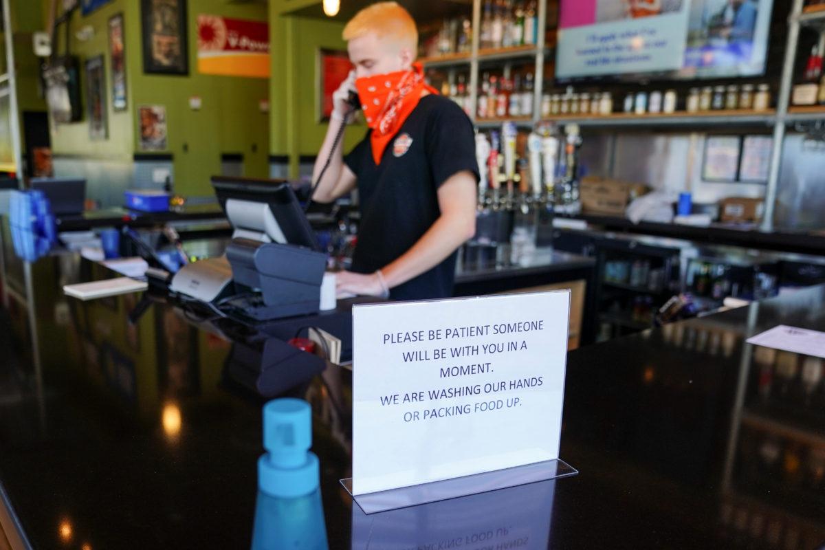 Masks Temperature Checks Mark New Normal At Reopening