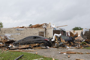 DELETE ON 5/13/20 A home had its roof torn off after a tornado ripped through Monroe, La. just before noon on Sunday, April 12, 2020 causing damage to a neighborhood and the regional airport. (Nicolas Galindo/The News-Star via AP)