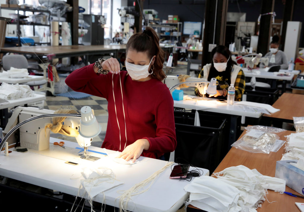 Analiese Zaleski sews hospital masks, as the spread of coronavirus disease (COVID-19) continues, on day one of turning the Detroit Sewn facility into a production facility for hospital masks in Pontiac, Michigan, U.S., March 23, 2020. REUTERS/Rebecca Cook - RC2XPF9SS4FS